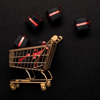 Einkaufswagen und geschenkboxen