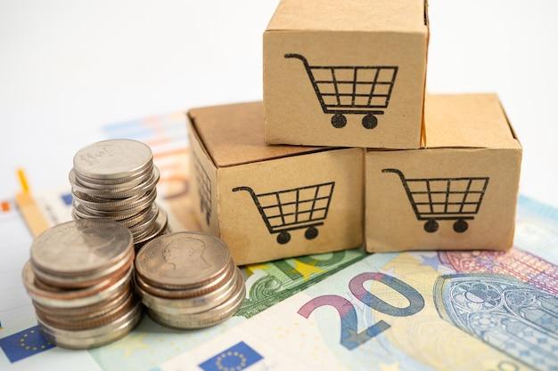 Einkaufswagenlogo auf box mit us-dollar-banknoten