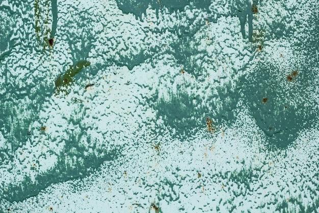 Eisenoberfläche wird mit altem grünem farbenbeschaffenheitshintergrund bedeckt