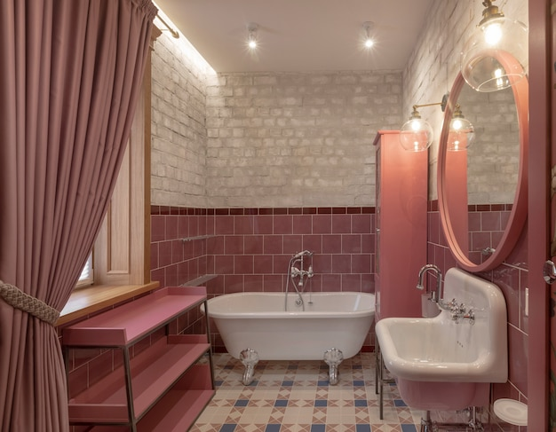 Elegantes badezimmer mit modernem design in rosa farbe