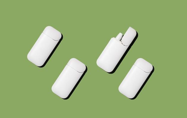 Elektronische zigaretten auf grünem hintergrund rauchkonzept
