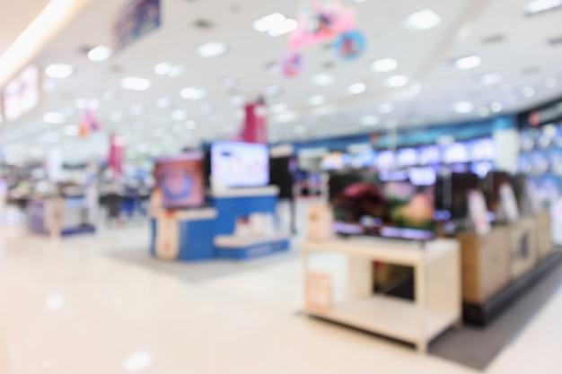 Elektronisches kaufhaus zeigen fernseher, fernseher und haushaltsgeräte mit bokeh-licht unscharfem hintergrund