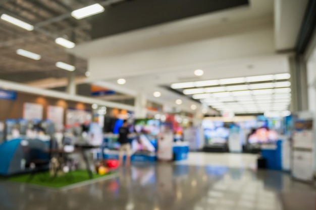 Eletronic kaufhausshow fernsehfernsehen und haushaltsgerät mit bokeh-licht verschwommenem hintergrund
