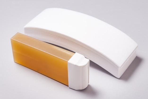 Enthaarungswachskatrone und papierblätter, werkzeugset für haarentfernungswachs