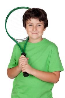 Entzückendes kind mit einem tennisschläger getrennt auf über weiß