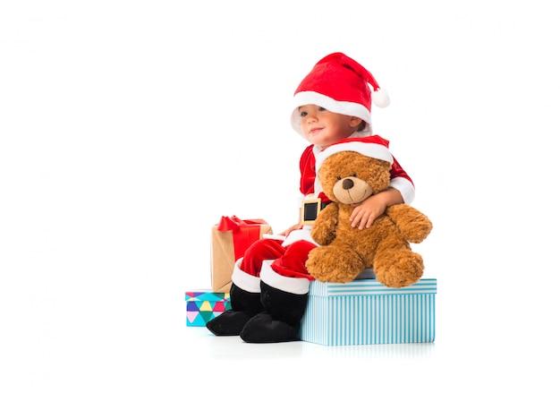 Entzückendes kleines baby gekleidet als weihnachtsmann an den weihnachtsfeiern