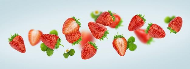 Erdbeere lokalisiert auf grauem hintergrund, fallende erdbeeren