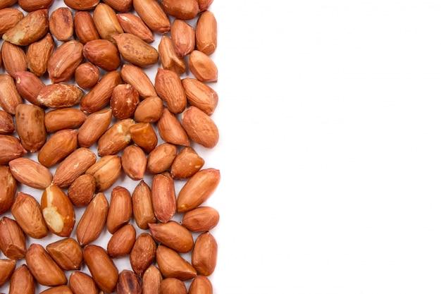 Erdnüsse, für hintergrund. in schalenerdnüssen ungereinigt.