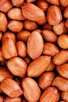 Erdnüsse oder texturen. ungereinigte erdnüsse in der schale.