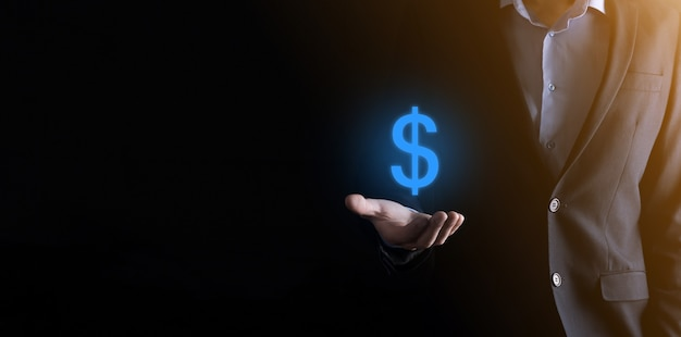 Erfolgreiches internationales finanzsymbol-sinvestment-konzept mit geschäftsmannmann-person halten wachstum, diagramme und dollarzeichen, digitale technologie.