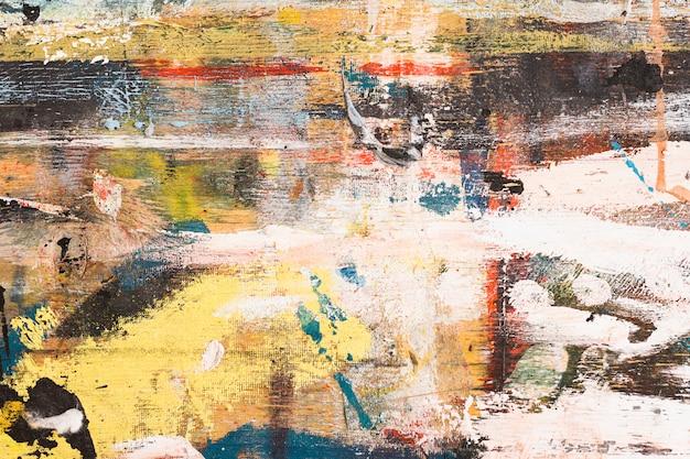 Erhöhte ansicht des unordentlichen bunten abstrakten pinselstrichs gemasert