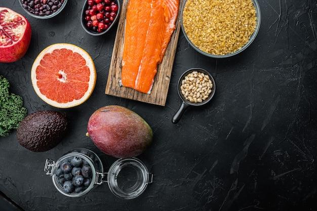Ernährungsplan für gesunde ernährung. essensplanung, flach liegen, auf schwarzem tisch