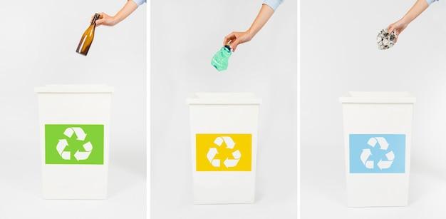 Ernten sie die hände, die abfall in den behältern werfen