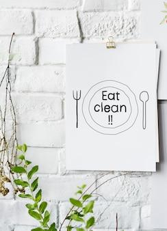 Essen sie saubere lebensmittelinspiration auf papierplakat auf weißer wand