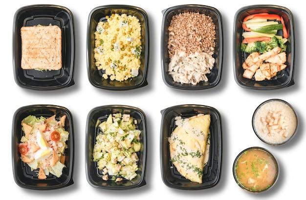Essenslieferung auf weißem hintergrund. diätmahlzeiten für veganer.