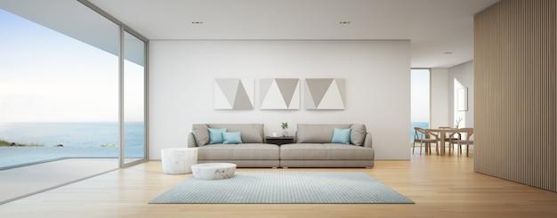 Esszimmer und wohnzimmer des luxus-sommerstrandhauses mit meerblick und swimmingpool in der nähe der holzterrasse.