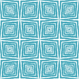 Ethnisches handgemaltes muster. türkisfarbener symmetrischer kaleidoskophintergrund. sommerkleid ethnische handbemalte fliese. textilfertiger zarter druck, badebekleidungsstoff, tapete, verpackung.