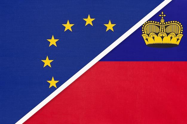 Europäische union oder eu gegen fürstentum liechtenstein nationalflagge aus textil.