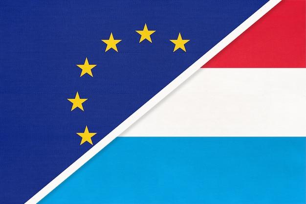 Europäische union oder eu gegen großherzogtum luxemburg nationalflagge aus textil.
