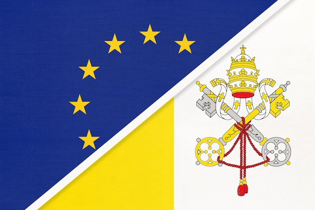 Europäische union oder eu gegen vatikanstadt staatsflagge aus textil.
