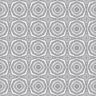 Exotisches nahtloses muster. schwarzer symmetrischer kaleidoskophintergrund. textilfertiger atemberaubender druck, bademodenstoff, tapete, verpackung. sommer bademode exotisches nahtloses design.
