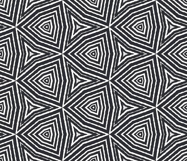 Exotisches nahtloses muster. schwarzer symmetrischer kaleidoskophintergrund. textilfertiger edeldruck, bademodenstoff, tapete, verpackung. sommer bademode exotisches nahtloses design.