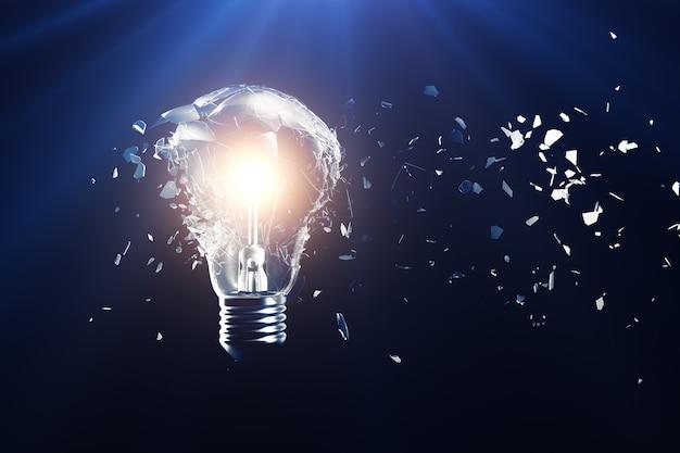 Explodierende glühlampe auf einem blau