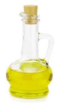 Extra olivenölflasche isoliert auf einem weißen.