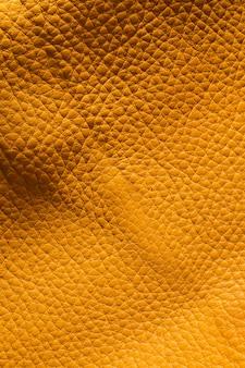 Extrem strukturiertes goldenes leder in nahaufnahme