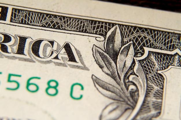 Extreme makroaufnahme eines ein-dollar-scheines, selektiver fokus