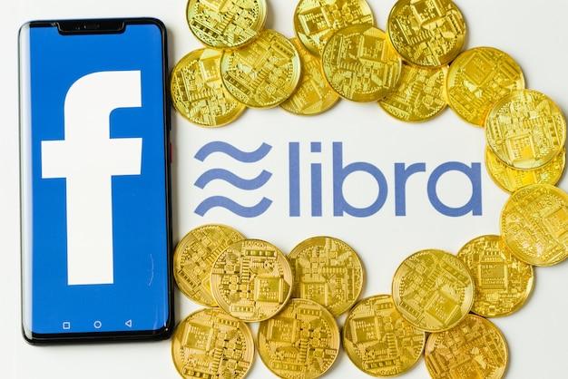 Facebook und libra logo, neue elektronische währung.