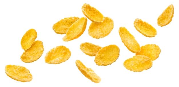 Fallende cornflakes isoliert auf weißer oberfläche mit beschneidungspfad