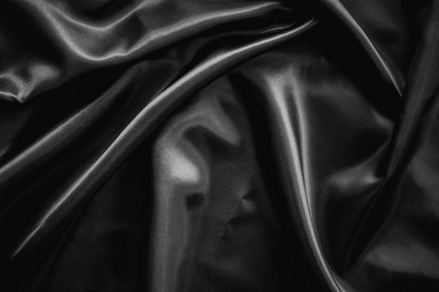 Falten schwarzer satin stoff textur hintergrund
