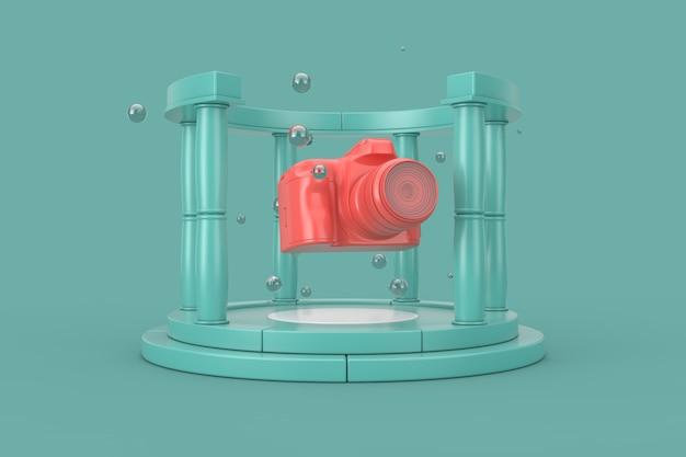 Fantasie-schöne moderne digitale rosa foto-kamera in der mitte des aquamarine-steinantiken-podiums mit spalten auf einem aquamarinhintergrund. 3d-rendering