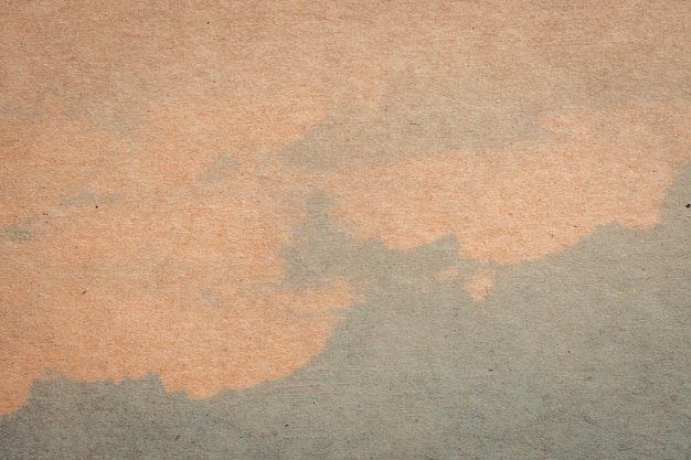 Farbbeschaffenheit und -hintergrund des braunen papiers und des blauen wassers mit raum.