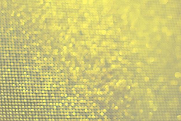 Farben des jahres 2021 ultimativer grauer und leuchtender hintergrund. hellbeige, gelbe verschwommene lichter. bokeh. textur.