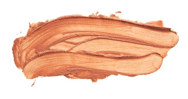 Farbfeld aus braunem lippenstift, abstrich isoliert auf weiß, nahaufnahme