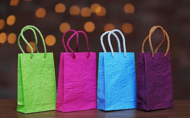 Farbige einkaufstüten auf weihnachtsoberfläche