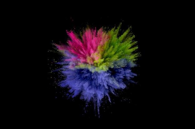 Farbige pulverexplosion. abstrakter nahaufnahmestaub auf hintergrund. bunte explodieren. holi paint malen
