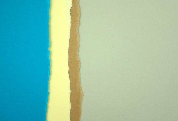 Farbiges papier abstrakte textur hintergrund leer zerrissen blau neutral pastell erdton grau