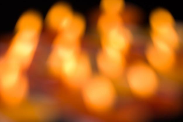 Feiertagshintergrund des funkelns verwischte goldene lichter