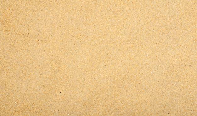 Feiner horizontaler hintergrund des gelben sandes