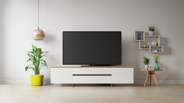 Fernsehapparat auf dem kabinett im modernen wohnzimmer mit anlage auf weißer wand
