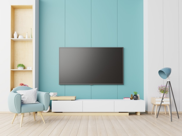 Fernsehapparat auf dem kabinett im modernen wohnzimmer mit lehnsessel auf blauem wandhintergrund.