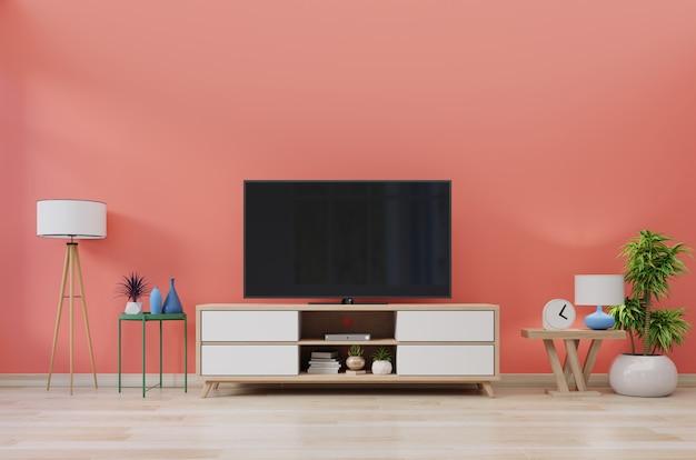Fernsehapparat im modernen raum mit dekoration auf lebendem korallenrotem wandhintergrund