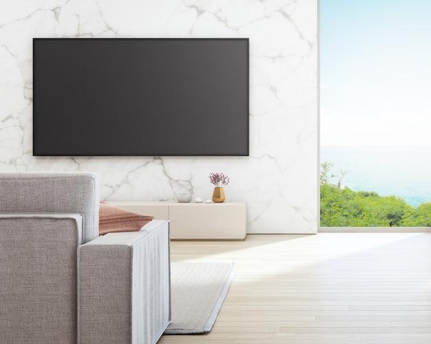 Fernsehen auf weißer marmorwand gegen sofa im ferienheim oder im ferienlandhaus.