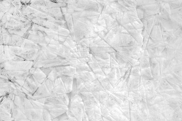 Fester hintergrund aus eis- und schneekristallen mit rissen und textur