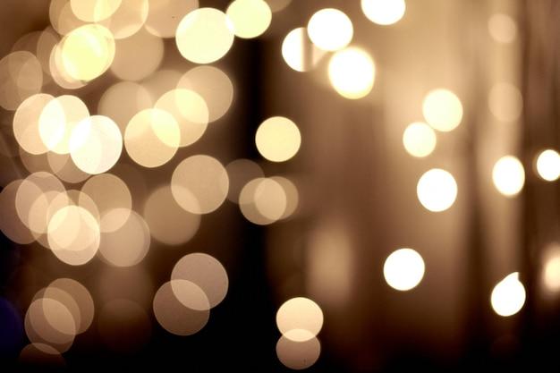 Festliche gelbe weihnachtslichter Premium Fotos