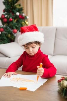 Festliche wunschliste des kleinen jungen, die schreibt