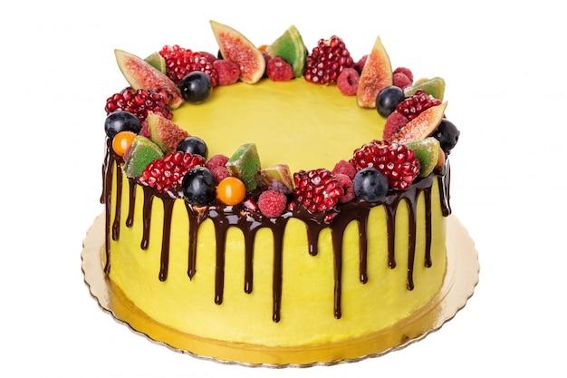 Festlicher obstkuchen aus süßen ornamenten am tag der geburt.